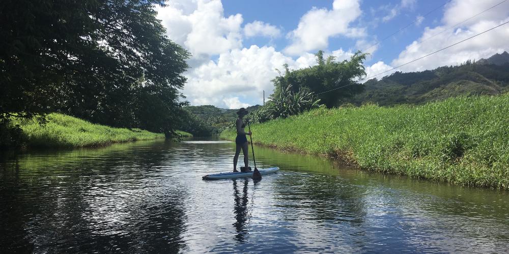 Kat paddle boarding in Hanalei Bay